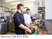 Купить «chef and cook cooking food at restaurant kitchen», фото № 26971032, снято 2 апреля 2017 г. (c) Syda Productions / Фотобанк Лори