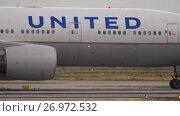 Купить «Boeing 777 taxiing before departure», видеоролик № 26972532, снято 19 июля 2017 г. (c) Игорь Жоров / Фотобанк Лори