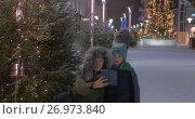 Купить «Mom and kid making winter selfie in the street with Christmas illumination», видеоролик № 26973840, снято 11 июля 2017 г. (c) Данил Руденко / Фотобанк Лори