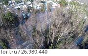 Купить «Aerial winter view of houses in village near the forest», видеоролик № 26980440, снято 21 апреля 2016 г. (c) Данил Руденко / Фотобанк Лори