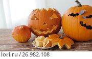 Купить «jack-o-lantern or carved halloween pumpkins», видеоролик № 26982108, снято 20 сентября 2017 г. (c) Syda Productions / Фотобанк Лори
