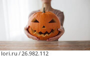 Купить «close up of woman with halloween pumpkin at home», видеоролик № 26982112, снято 20 сентября 2017 г. (c) Syda Productions / Фотобанк Лори