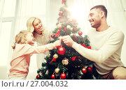 Купить «happy family decorating christmas tree at home», фото № 27004032, снято 8 октября 2015 г. (c) Syda Productions / Фотобанк Лори