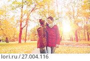 Купить «happy young couple walking in autumn park», фото № 27004116, снято 9 октября 2016 г. (c) Syda Productions / Фотобанк Лори