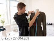 Купить «fashion designer with dummy making dress at studio», фото № 27004208, снято 28 июня 2017 г. (c) Syda Productions / Фотобанк Лори
