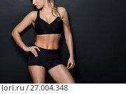 Купить «close up of woman in black sportswear posing», фото № 27004348, снято 26 апреля 2017 г. (c) Syda Productions / Фотобанк Лори