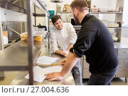 Купить «chef and cook with grocery list at kitchen», фото № 27004636, снято 2 апреля 2017 г. (c) Syda Productions / Фотобанк Лори