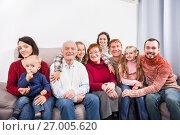 Купить «Family members making family photo», фото № 27005620, снято 26 мая 2019 г. (c) Яков Филимонов / Фотобанк Лори