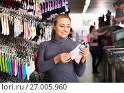 Купить «Woman shopping socks in leg-wear», фото № 27005960, снято 27 января 2020 г. (c) Яков Филимонов / Фотобанк Лори