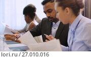 Купить «happy business team at international conference», видеоролик № 27010016, снято 17 сентября 2019 г. (c) Syda Productions / Фотобанк Лори