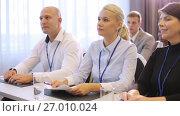 Купить «happy business team at international conference», видеоролик № 27010024, снято 22 января 2020 г. (c) Syda Productions / Фотобанк Лори