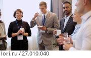 Купить «happy business team at international conference», видеоролик № 27010040, снято 22 января 2020 г. (c) Syda Productions / Фотобанк Лори