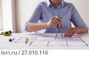 Купить «female architect with compass measuring blueprint», видеоролик № 27010116, снято 7 сентября 2017 г. (c) Syda Productions / Фотобанк Лори