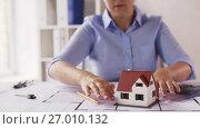 Купить «female architect with house model and blueprint», видеоролик № 27010132, снято 7 сентября 2017 г. (c) Syda Productions / Фотобанк Лори