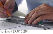 Купить «architect hands with ruler measuring blueprint», видеоролик № 27010204, снято 7 сентября 2017 г. (c) Syda Productions / Фотобанк Лори