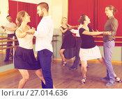 Купить «Three happy couples dancing tango», фото № 27014636, снято 28 февраля 2020 г. (c) Яков Филимонов / Фотобанк Лори