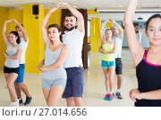 Купить «sporty girls and men learning salsa steps», фото № 27014656, снято 21 июня 2017 г. (c) Яков Филимонов / Фотобанк Лори