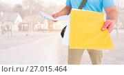 Купить «Delivery man mid section with letters against blurry housing estate», фото № 27015464, снято 25 июня 2019 г. (c) Wavebreak Media / Фотобанк Лори