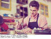 Купить «Carpenter working in studio», фото № 27029096, снято 8 апреля 2017 г. (c) Яков Филимонов / Фотобанк Лори