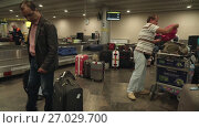 Купить «Suitcases in the baggage claim area are waiting for the owners who are stuck in the queue at passport control at Sheremetyevo International Airport. stock footage video», видеоролик № 27029700, снято 27 июня 2017 г. (c) Юлия Машкова / Фотобанк Лори