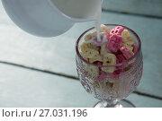 Купить «Milk being pour into glass of honeycomb cereal», фото № 27031196, снято 13 июня 2017 г. (c) Wavebreak Media / Фотобанк Лори