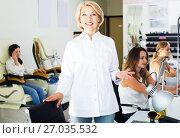 Купить «Woman manicurist in nail salon», фото № 27035532, снято 2 ноября 2016 г. (c) Яков Филимонов / Фотобанк Лори