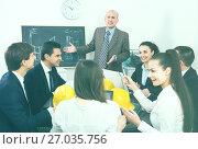 Купить «Team of engineers discussing project», фото № 27035756, снято 7 декабря 2019 г. (c) Яков Филимонов / Фотобанк Лори
