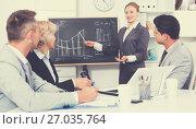 Купить «Businesswoman discussing business project with team», фото № 27035764, снято 1 июля 2017 г. (c) Яков Филимонов / Фотобанк Лори
