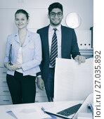 Купить «Businessman and businesswoman in office», фото № 27035892, снято 1 июня 2017 г. (c) Яков Филимонов / Фотобанк Лори