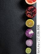 Купить «Overhead view of fruits and vegetables arranged on slate», фото № 27036808, снято 12 июня 2017 г. (c) Wavebreak Media / Фотобанк Лори