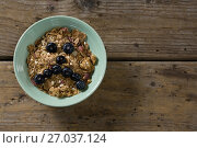 Купить «Oats with blueberries forming face», фото № 27037124, снято 13 июня 2017 г. (c) Wavebreak Media / Фотобанк Лори