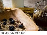 Купить «Oats and berry in plate with jar of honey», фото № 27037184, снято 13 июня 2017 г. (c) Wavebreak Media / Фотобанк Лори