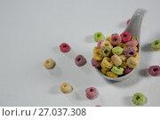 Купить «Froot loops in spoon», фото № 27037308, снято 13 июня 2017 г. (c) Wavebreak Media / Фотобанк Лори