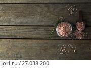 Купить «Himalayan salt and rosemary on wooden table», фото № 27038200, снято 5 июня 2017 г. (c) Wavebreak Media / Фотобанк Лори