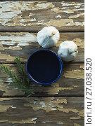 Купить «Garlic bulbs, rosemary and oil on wooden table», фото № 27038520, снято 5 июня 2017 г. (c) Wavebreak Media / Фотобанк Лори