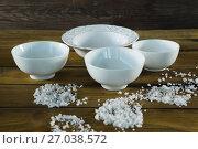 Купить «Bowls and sea salt scattered», фото № 27038572, снято 5 июня 2017 г. (c) Wavebreak Media / Фотобанк Лори