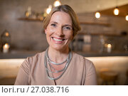Купить «Portrait of beautiful woman standing in restaurant», фото № 27038716, снято 28 мая 2017 г. (c) Wavebreak Media / Фотобанк Лори