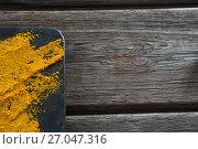 Купить «Turmeric powder on board», фото № 27047316, снято 5 июня 2017 г. (c) Wavebreak Media / Фотобанк Лори