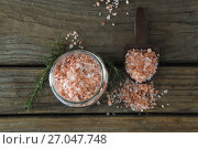 Купить «Himalayan salt and rosemary on wooden table», фото № 27047748, снято 5 июня 2017 г. (c) Wavebreak Media / Фотобанк Лори