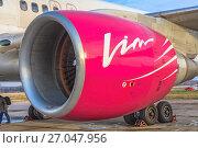 Купить «Реактивный двигатель современного пассажирского самолета авиакомпании «ВИМ-Авиа»», фото № 27047956, снято 1 ноября 2010 г. (c) Владимир Сергеев / Фотобанк Лори