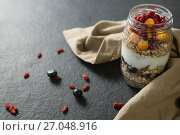 Купить «Yogurt with pomegranates and golden berries in glass jar», фото № 27048916, снято 13 июня 2017 г. (c) Wavebreak Media / Фотобанк Лори