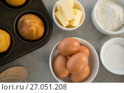 Купить «Directly above shot of ingredients by muffin tin», фото № 27051208, снято 5 мая 2017 г. (c) Wavebreak Media / Фотобанк Лори