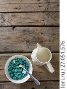 Купить «Bowl of froot loops and marshmallow with milk jug», фото № 27051576, снято 13 июня 2017 г. (c) Wavebreak Media / Фотобанк Лори