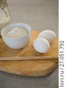 Купить «Flour and eggs on cutting board», фото № 27051792, снято 5 мая 2017 г. (c) Wavebreak Media / Фотобанк Лори