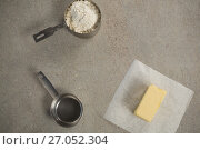 Купить «Butter on wax paper by strainer and flour in measuring cup», фото № 27052304, снято 5 мая 2017 г. (c) Wavebreak Media / Фотобанк Лори