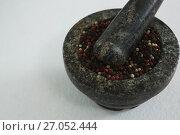 Купить «Black pepper in mortar and pestle», фото № 27052444, снято 5 июня 2017 г. (c) Wavebreak Media / Фотобанк Лори