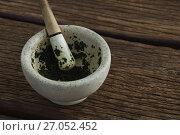 Купить «Herb paste in mortar and pestle on wooden table», фото № 27052452, снято 5 июня 2017 г. (c) Wavebreak Media / Фотобанк Лори