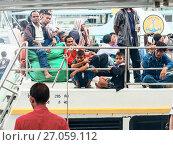 Купить «Люди мрачно ждут на палубе парома отправления», фото № 27059112, снято 19 декабря 2010 г. (c) Эдуард Паравян / Фотобанк Лори