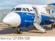 Купить «Самолет Ан-148-100Е (бортовой номер RA-61709) авиакомпании «Полет» на обслуживании в московском международном аэропорту Домодедово. Май 2012 года», фото № 27059128, снято 22 мая 2012 г. (c) Владимир Сергеев / Фотобанк Лори
