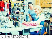 Купить «Two positive women tailors working with sewing machines», фото № 27060744, снято 17 июля 2019 г. (c) Яков Филимонов / Фотобанк Лори